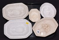 Lot 216 - Five assorted 19th Century creamware and other blancmange dishes