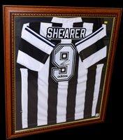 Lot 91 - A Newcastle United replica football shirt...