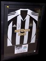 Lot 90 - A Newcastle United replica shirt signed by...