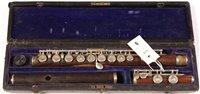 Lot 5 - An Isidor Lot B&S model L rosewood flute...