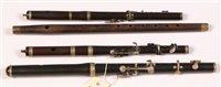 Lot 31 - An ebony flute by Henry Potter London dated...