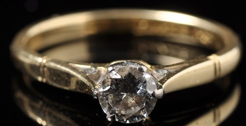 Lot 723-A single stone solitaire diamond ring, the...