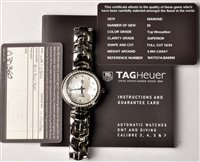 Lot 681-Tag Heuer: a lady's stainless steel wristwatch