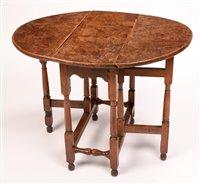1015 - An Elm drop leaf table,