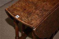 Lot 1015-An Elm drop leaf table