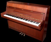 944 - An upright overstrung piano.