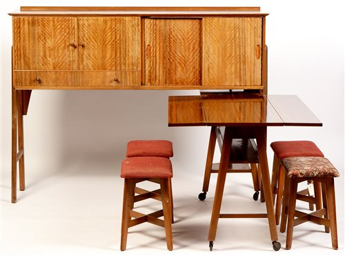 Lot 1093-Manner of Gordon Russell: sideboard unit/dining table; and four stools.