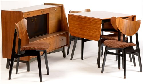 Lot 1116-G-Plan: a teak and ebonised six-piece dining room suite.