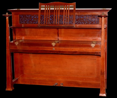 Lot 884 - An Arts & Crafts upright overstrung piano.