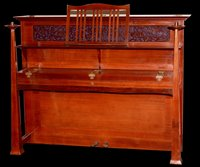 884 - An Arts & Crafts upright overstrung piano.