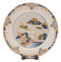 105 - A mid 18th Century London Delftware charger.