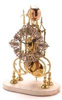 937 - A Victorian brass skeleton timepiece.