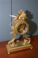 Image for A star burst pendulum clock.