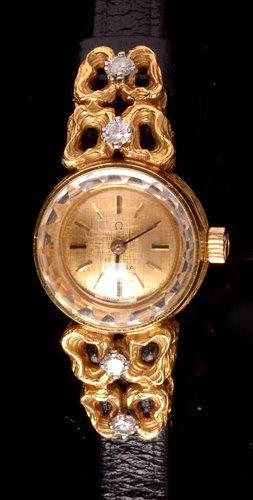 Lot 699-An Omega 18k cocktail watch.