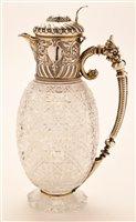 Lot 572 - Cut Glass silver mounted claret jug
