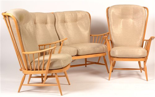 1097 - Ercol: a light beech Windsor style three-piece suite.