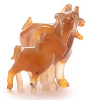 Lot 28 - An early 20th Century Chinese carved agate group of a goat and kid.
