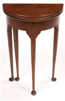 Image for A demi lune occasional table.