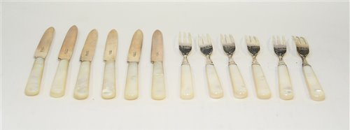 Lot 562-Mother of pearl and silver fruit knives and forks