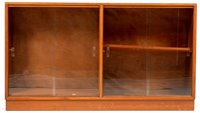 1085 - Manner of Gordon Russell: a mid 20th Century walnut glazed bookcase.