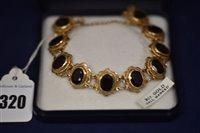 Lot 320-9ct Gold and Garnet bracelet
