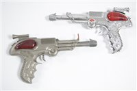 Lot 1550 - Two Lone Star 'Space Outlaw' metal pistols