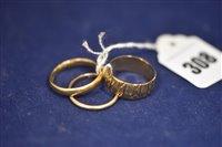 Lot 308-Three gold rings