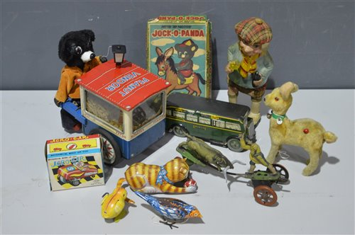 Lot 1101-Tin plate clockwork toys
