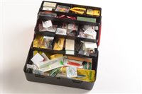 Lot 57-A Black and Red fishing tackle box containing a variety of lures
