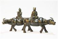 Lot 26 - Pair of bronze water buffalo ornaments.