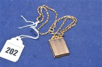 Lot 202-9ct gold pendant and yellow metal chain