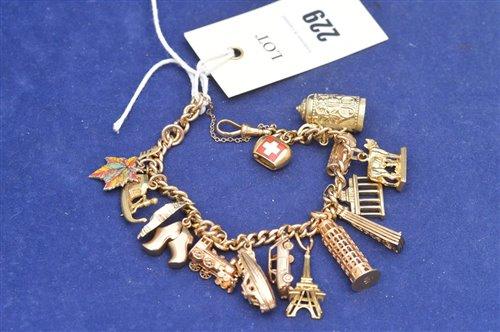 Lot 229-18ct yellow gold charm bracelet