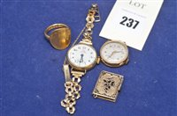 Lot 237-Gold coin ring, ladies watch, another book locket