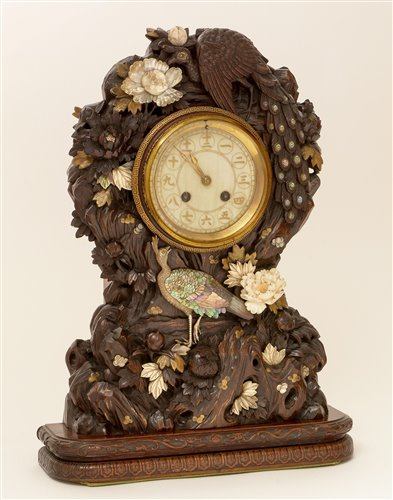 Lot 676 - A rare and unusual Japanese carved mantel clock.