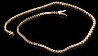Lot 499-Diamond line necklace