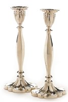 Lot 395-Pair of silver candlesticks