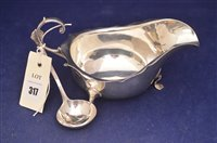 Lot 317-Silver sauceboat and ladle