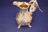 Lot 319-Victorian embossed silver milk jug