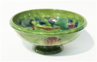 Lot 74 - A William Moorcroft for Liberty 'Claremont' pattern footed bowl.