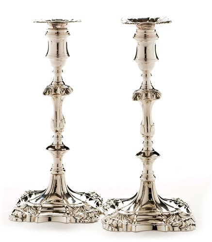 422 - A pair of George III candlesticks.