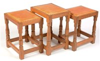 Image for Robert Thompson of Kilburn: A 'Mouseman' stool; and two matching smaller stools.