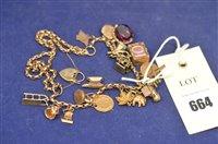 Lot 664 - Yellow metal charm bracelet