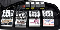 Lot 104 - Four Electro Harmonics foot pedals; and soft case.