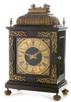 Lot 748 - An 18th Century style ebonised and gilt bronze bracket clock; and associated bracket.