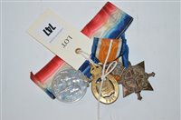 Lot 747 - First World War medals and a badge