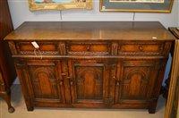 Lot 1040 - carved oak sideboard