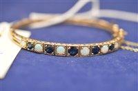 Lot 726 - Sapphire and opal bangle