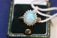 Lot 724 - Opal and diamond ring