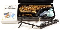 Lot 4-Yamaha Alto saxophone and accessories.