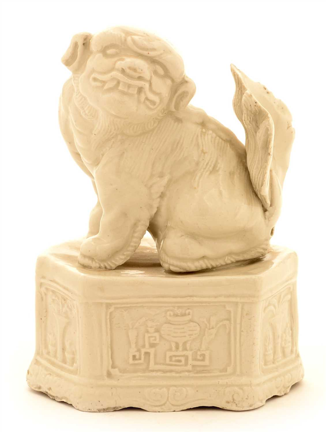 Lot 8-A Chinese blanc de chine porcelain figure of a Buddhist lion of fu dog.